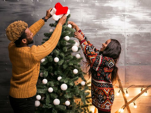 couple-hanging-decorations-christmas-tree.jpg