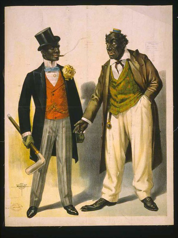 two-performers-in-blackface-facing-each-other-one-in-tuxedo-other-in-suit.jpg