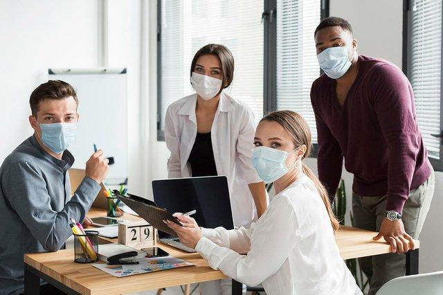 working-office-during-pandemic-wearing-face-masks.jpg