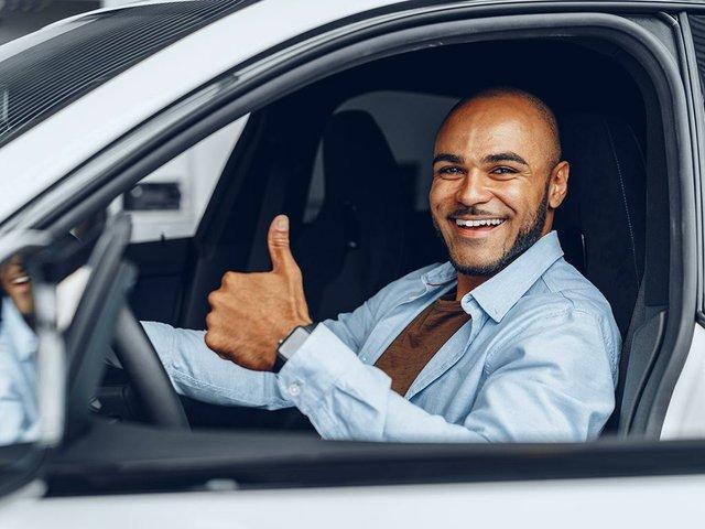 portrait--man-sitting-in-his-car.jpg