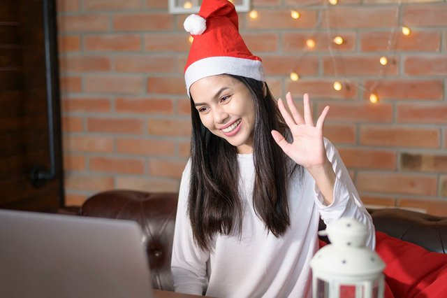 young-smiling-woman-wearing-red-santa-claus-hat-making-video-call-social-network-christmas-day.jpg