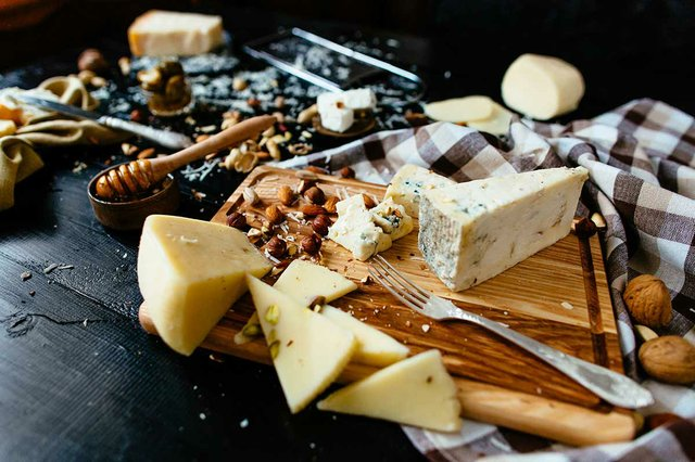 composition-of-different-varieties-of-cheese-with-honey-nuts.jpg