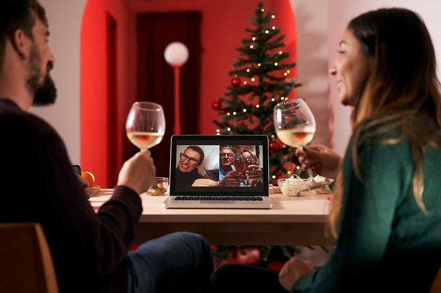 couple-celebrating-christmas-making-video-call-in-times-of-coronavirus.jpg