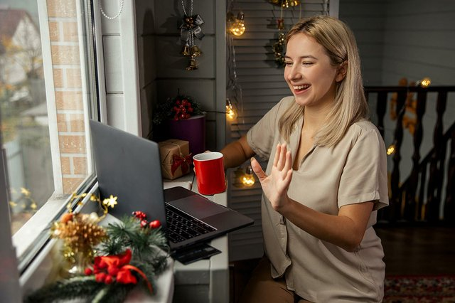 young-woman-with-cup-coffee-using-zoom-congratulate-merry-christmas-her-relatives-making-facetime-video-calling-with-laptop-home.jpg