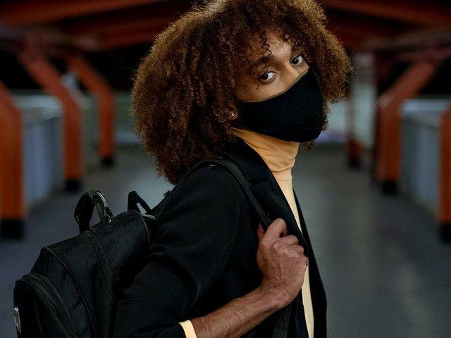 masked-woman-in-train-station.jpg