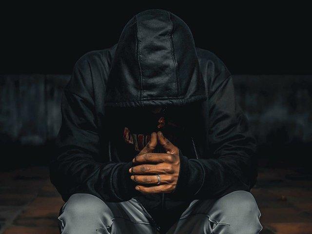 frustrated-man-hoodie-over-head.jpg