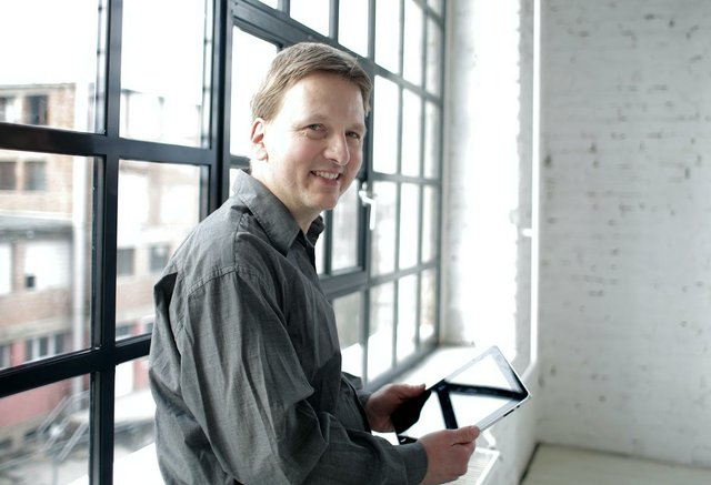 man-in-window-with-tablet.jpg
