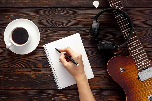 electric-guitar-with-headphones-coffee-desktop.jpg