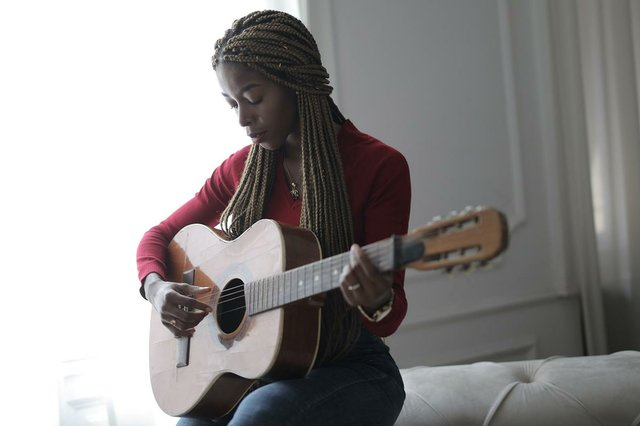woman-playing-guitae-at-home.jpg