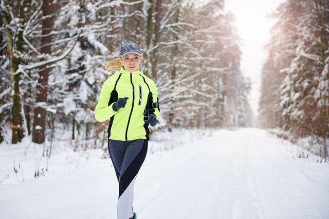 woman-running-winter-forest.jpg