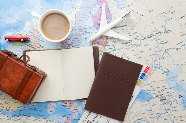 travel-trip-vacation-tourism-close-up-note-book-suitcase-airplane-map.jpg