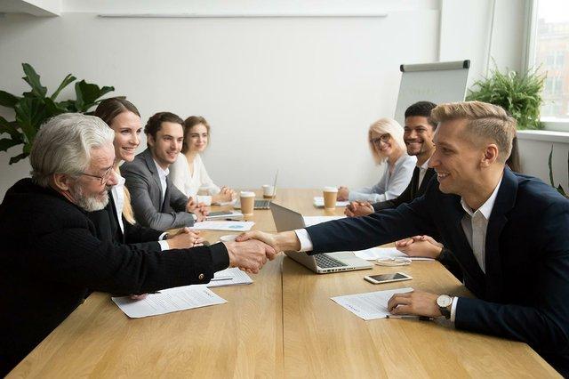 investor-startup-handshaking-young-entrepreneurs.jpg