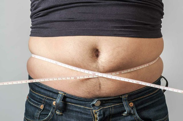 man-check-out-his-body-fat-measuring-tape.jpg