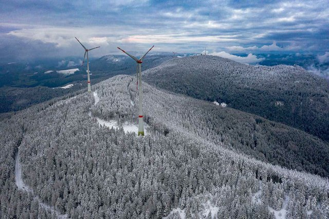 wind-turbines-winter-snow-cloudy-sky.jpg