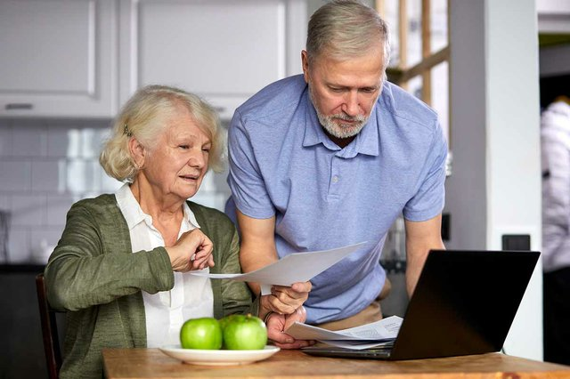 man-and-woman-managing-family-monthly-budget-together-focused-married-couple-using-computer-banking-application-paying-bills-in-the-kitchen.jpg