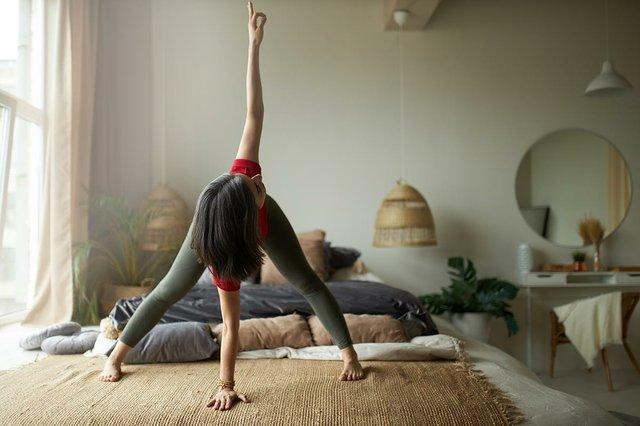 woman-doing-yoga-exercising-at-home.jpg