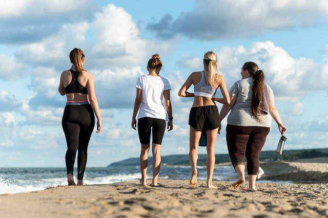 back-view-women-walking-beach.jpg