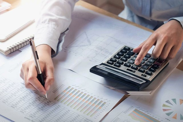 finance-accounting-concept-business-woman-working-on-desk-using-calculator.jpg