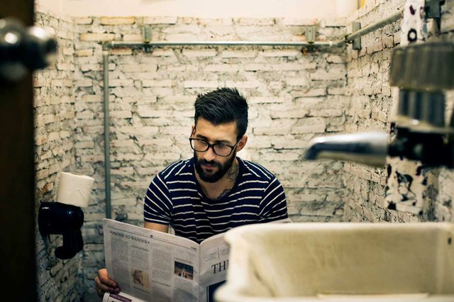 man-restroom-reading-newspaper-toilet.jpg