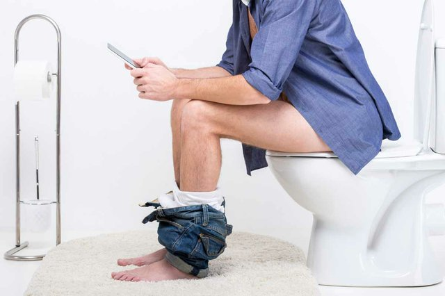 businessman-with-tablet-while-sitting-toilet.jpg