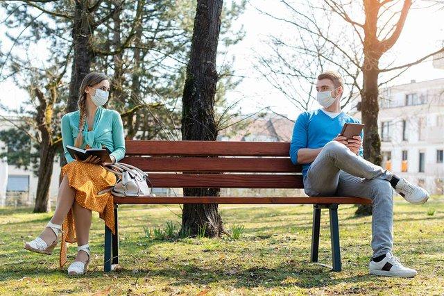 woman-man-social-distancing-sitting-bench-park.jpg