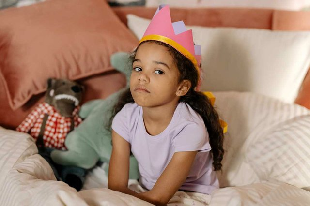 gender-roles-little-girl-with-princess-corwn-looks-unhappy.jpg