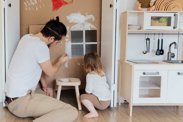 gender-roles-man-with-little-girl-playing-house.jpg
