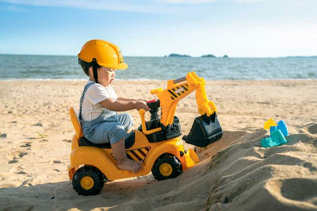 gender-roles-boy-play-excavator-toy-beach.jpg