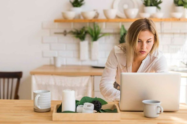 woman-working-from-home-with-laptop-in-kitchen.jpg