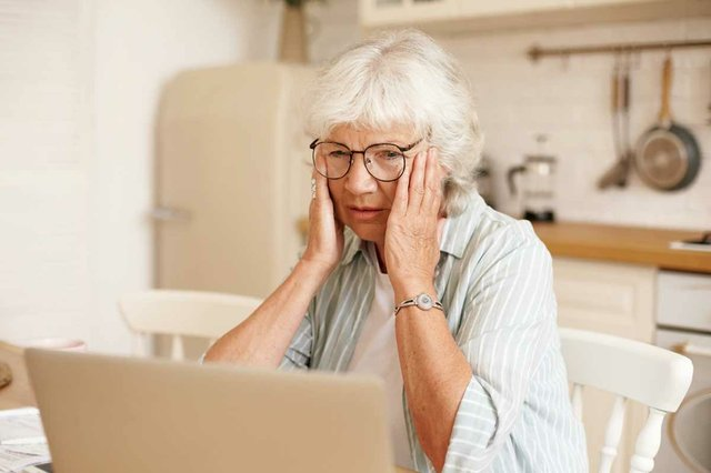 retired-woman-with-gray-hair-looks-frustrated-stressed-using-laptop.jpg