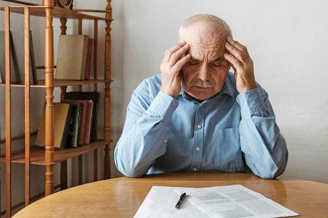 stressed-worried-man-looking-form.jpg
