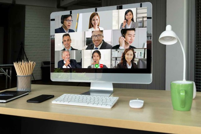 video-call-business-networking-meeting-on-large-computer-screen.jpg
