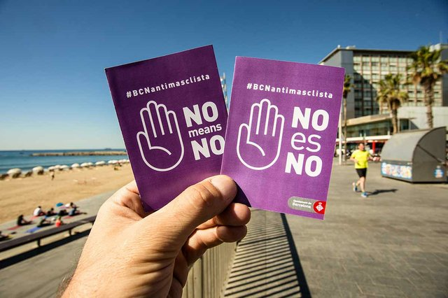 close-up-of-a-hand-holding-two-antimaclista-pamphlets-Barcelona-city-campaign.jpg