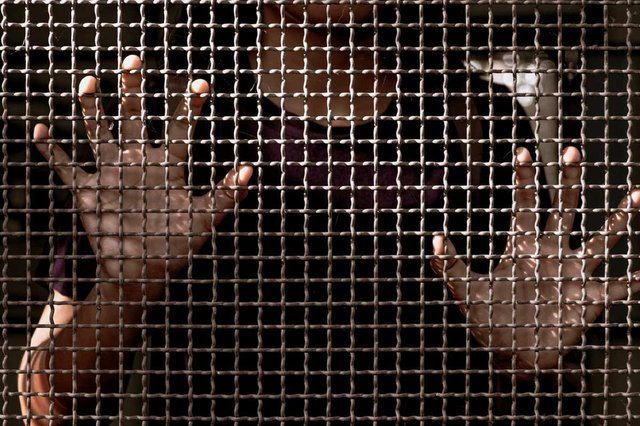 close-up-of-womans-hand-holding-fence.jpg