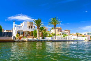 house-with-palm-by-water-spain.jpg