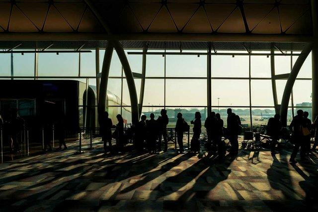 crowd-passengers-luggage-waiting-departure-area-airport-terminal.jpg