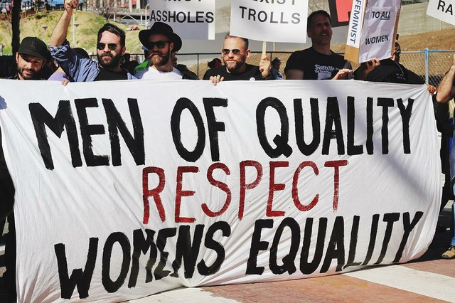 men-at-protest-holding-sign-that-reads-men-of-quality-respect-womens-equality.jpg