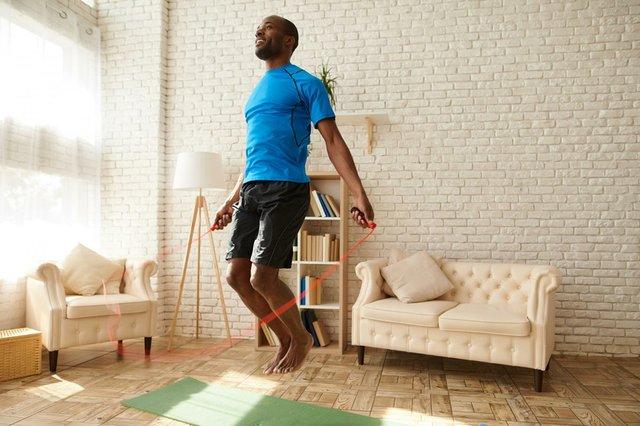man-at-home-jumping-rope-in-livingroom.jpg