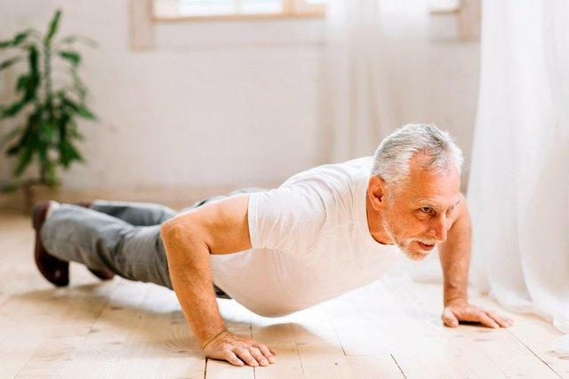 senior-man-doing-pushup-exercise-om-hardwood-floor.jpg