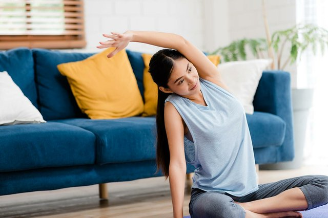 young-woman-practicing-yoga-living-room.jpg