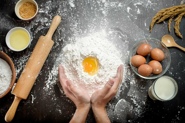 top-view-of-bread-ingredients-on-the-counter-man-making-bread.jpg