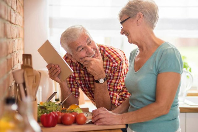 retired-couple-making-salad-together-in-the-kitchen.jpg