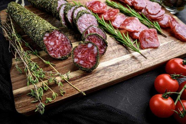 spanish-fuet-sausage-slices-balck-background.jpg
