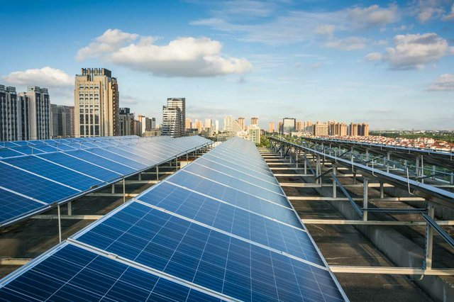 photovoltaic-panels-in-front-of-city.jpg