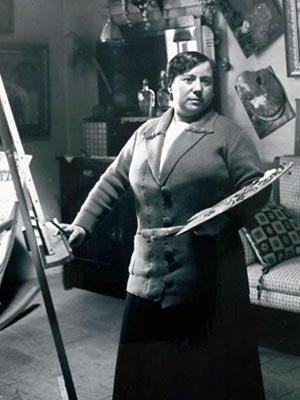 Lluïsa-Vidal-standing-at-an-easel-painting.jpg
