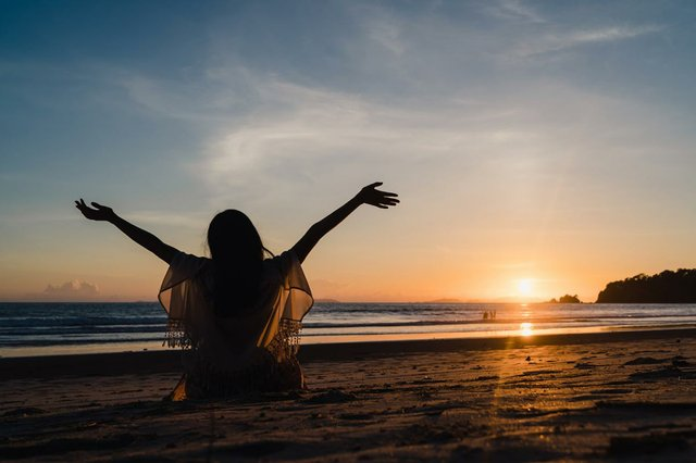 woman-watching-sunset-near-beach-beautiful-female-happy-relax-enjoy-moment-when-sunset-evening.jpg