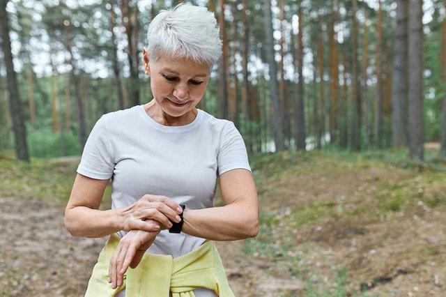 woman-athlete-fitness-tracker-walking-in-park.jpg