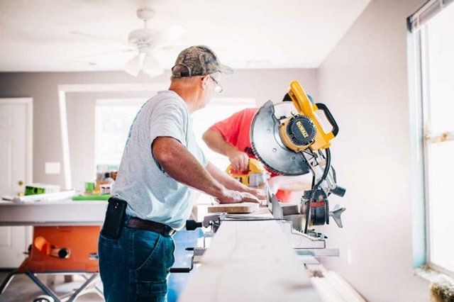 two-men-working-on-construction-in-home-renovation.jpg