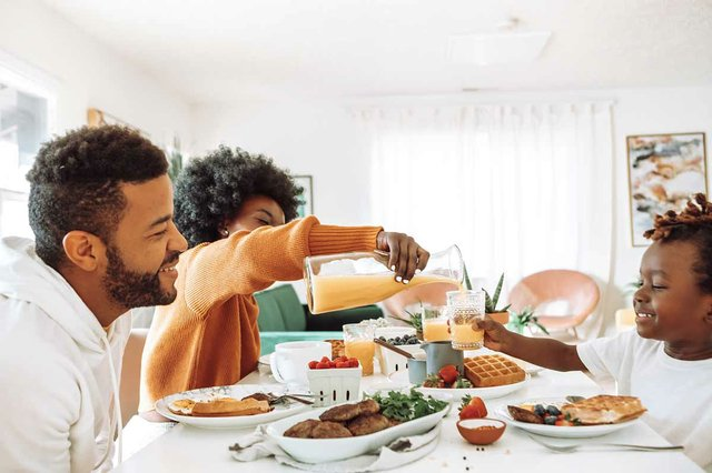family-sitting-together-eating-breakfast-at-home.jpg