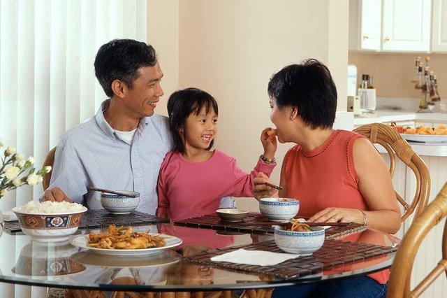 family-sitting-together-eating-breakfast.jpg